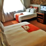 Luxurious bedroom with queen bed and single bed family/business - TASA Lodge, Midrand Accommodation B&B
