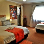 Super king bed within lion suite - TASA Lodge, Midrand Accommodation B&B